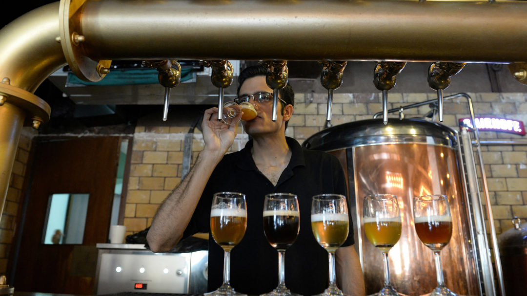 The Biere Club's head brewer Rohit Parwani tastes craft beer at the microbrewery in Bangalore. (AFP/Jiji)